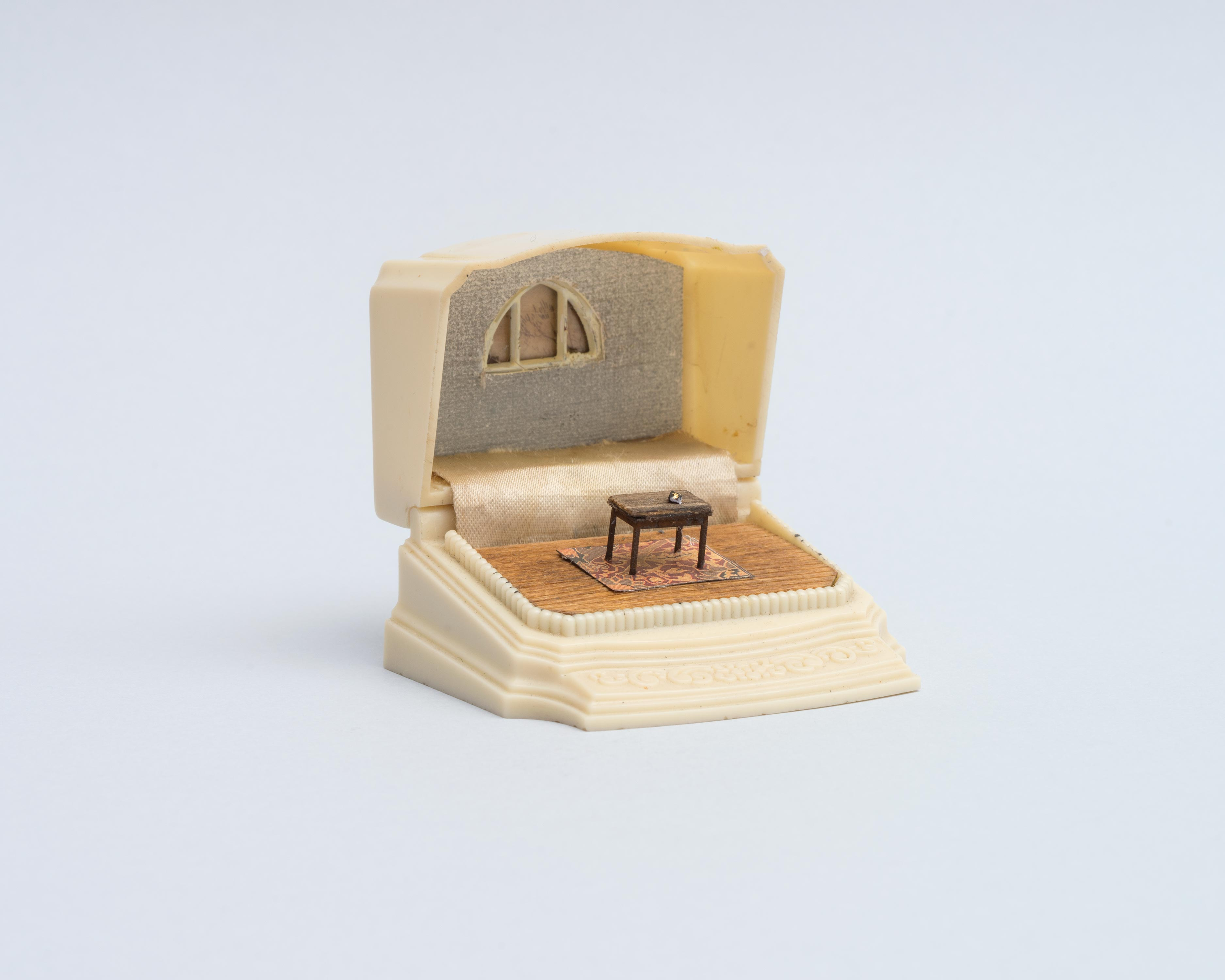 Curtis Talwst Santiago<br>1663 John Eliot's Algonquin (Native American Bible)<br>2016<br>Mixed media diorama in reclaimed jewelry box<br>2.625 x 2 x 2.5 in (6.7 x 5 x 6.4cm)